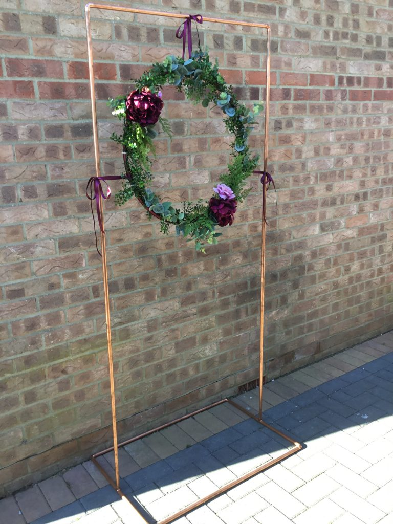 copper frame with floral hoop